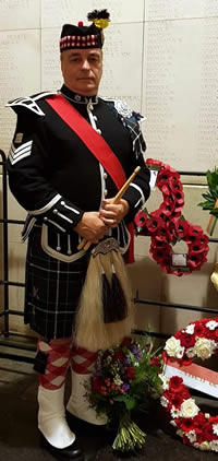Kernow Pipes and Drums lead tip Steve at the Menin Gate