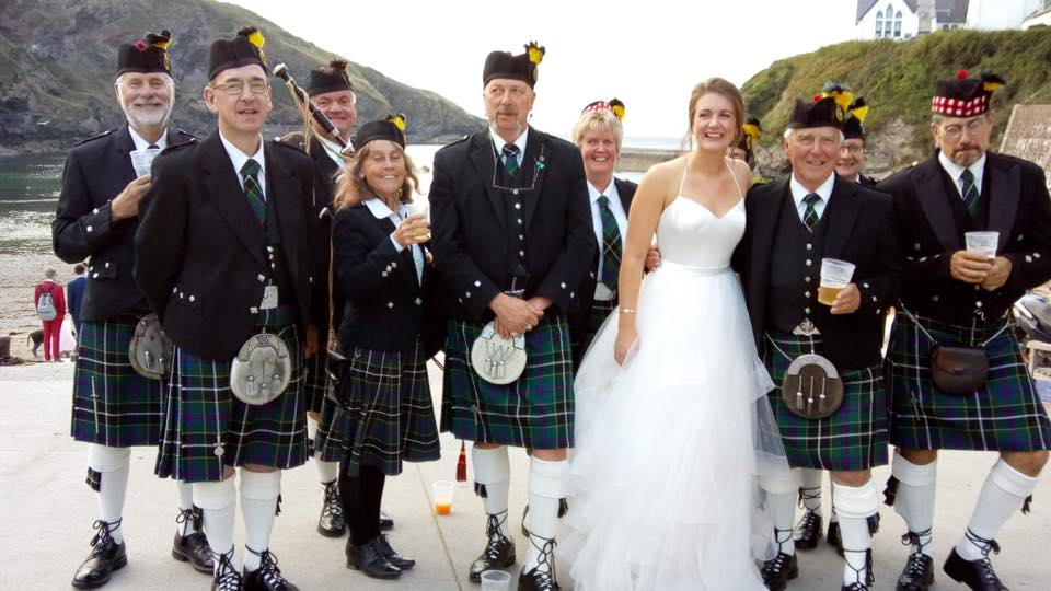 Kernow Pipes and Drums at Port Isaac carnival, with a newly wed bride!